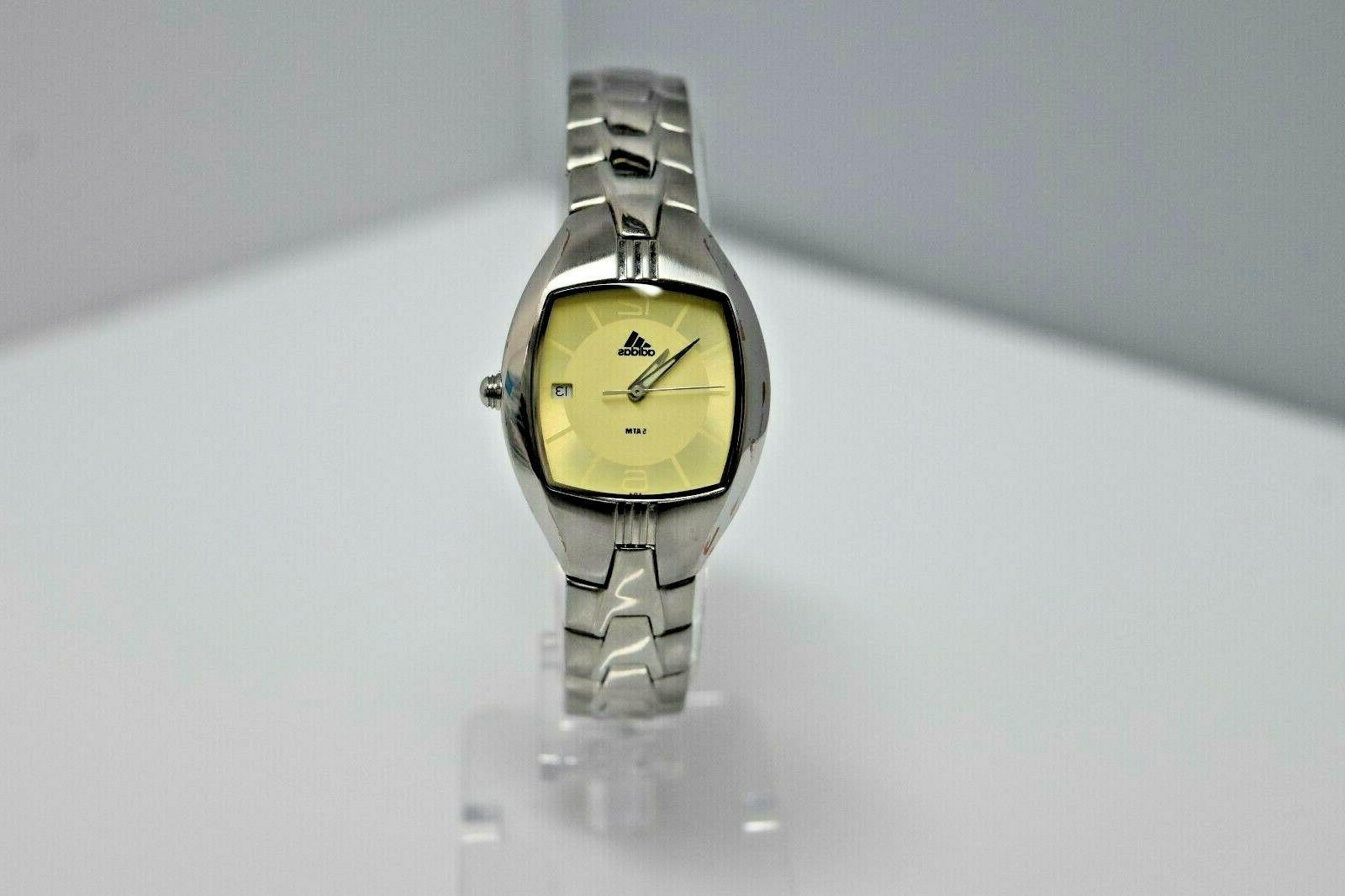 women s small stainless steel yellow dial